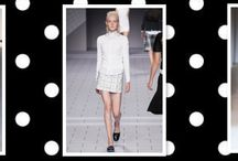 It's a Mad, Mod World / One of our favorite trends of Fall 2014 is the re-emergence of mod. Designers paired micro-minis with low-heeled boots for a feminine yet seriously sophisticated set of ensembles that flatter a myriad of body types.