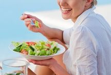 Women laughing alone with salad / by Heather Kennedy