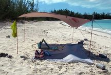 Kelty Noah's Tarp Beach Shelter/SunShade / We love the beach but I tend to burn very easily. When we booked a month long trip to Exuma in the Bahamas, I did some research and I realized that there was little or no shade on the beach so I would have to bring my own. So I did some research and discovered the Kelty Noah's tarp. We bought a 9'X9' tarp, aircraft aluminum poles and sandbags and we were set! This purchase turned out to be one of our best. It was light weight, easy to set up and provided the perfect amount of shade.