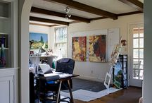 HOME REMODEL: Contemporary Art & Design / Falls Church, Virginia. The client did not want a bigger kitchen, but a better one. The wife is an artist, and display space for paintings was a constant quest. Cooktop was placed against the feature wall to create a dramatic focus for the hood. The backsplash treatment's dual tones blend stainless steel appliances and dark cabinets with clean lines, lending the composition depth. Limited wall cabinets were used to create an open feeling and to provide space for art.