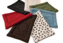 Goodies For Your Travel Buddies / Pet beds, dog collars, dog clothing.