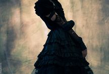 Ardent / Gothic high fashion shoot. Feather, punk influences, over the knee converse sneakers. Fashion photography.
