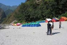 WHITE WATER RIVER RAFTING / ADVENTURE BEING A LIVE IN TEH FOOTHILLS OF HIMALAYAS BYASI BEACH TENTS
