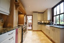"Quirky, Bespoke Kitchen design / Bespoke made to measure, shaker kitchen doors in the colours Oak, Cranberry and Timeless. Complimented with the stunning ""Verde Marinachi"" granite. Designed, supplied and installed by KITCHENCRAFT."