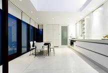 Modern Contemporary Kitchen / Beautiful sleek modern styled Contemporary Kitchen accentuated with deep stained wood framed windows.