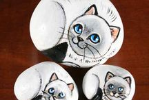 stone paintings of pets and animals / pets - and other animals - painted on to stones/rocks