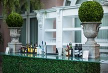 Boxwood Bars / Make the the quirky, talked about focal point of your venue by investing by making it into an artificial hedge!!