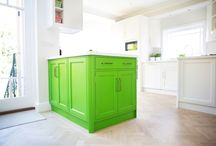 Green & Glorious / This bright, cheery and welcoming kitchen is the perfect space for food preparation, dining and sipping coffee with friends.  We love the bright green colour choice, the chunky Corian worktop and the beautiful parquet flooring.  A small desk area for taking care of daily admin has also been included.