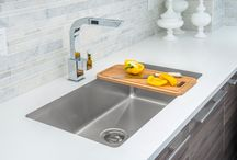 TopZero Seamless Undermount Sinks / TopZero rimless stainless steel sinks were designed to be undermounted to any solid countertop material, such as granite, quartz, or marble, wherein an upper interface between the stainless steel sink and the solid countertop comprises an upper seal which prevents water, bacteria or debris from entering between the rimless upper edge of the stainless steel sink and the top surface of the solid countertop.