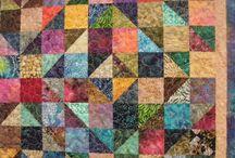 scrappy batik quilts / by Karen Ganske