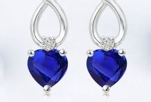 Solitaire-Heart-Tanzanite-And-Diamond-Ribbon-Cross-Earrings
