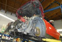 Mini Cooper Engine Replacement / Replacing the engine of a Mini Cooper requires removal of the front end.  Check out our mechanics hard at work.