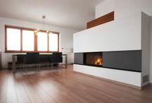 Eleganz / Die schwebende Kochzeile beeindruckt durch Eleganz und Schlichtheit und verleiht dem Raum eine ungewöhnliche Leichtigkeit. Die Qualität der Materialien zeigt sich zum Beispiel in dem handverlegten Nussbaumfurnier der Paneelwand, die einen perfekten Kontrast zu dem schwarzen italienischen Naturstein Nero Assoluto darstellt. Ausgestattet mit originalen, hochwertigen Elektrogeräten von Miele wird das Kochen in dieser Küche ein purer Genuss.