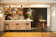 Colston St. Bar & Kitchen / An all-day venue inside Bristol's iconic live music and event space, the Colston Hall. Reclaimed industrial lighting and vintage school chairs give a lived-in feel that combines with a clean Scandinavian narrative of the bar construction.  Client: Bath Ales