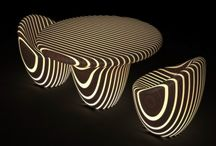 Bright Woods Collection / An enchanted forest of trees that light up at dusk, this is vision that let designer Giancarlo Zema to create an exclusive series of ethnic furniture for Luxyde. A collection with soft shapes and natural materials such as wood scratched by a flurry of resin rings that light up with LED technology and an RGB colour-changing effect. A collection with a table, chair, coffee table, pouf, floor lamp and table lamp, to stylishly and poetically furnish the most exclusive spaces from hotels to boats.