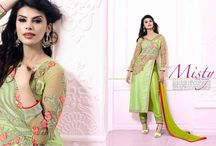 Attaractive Georgette and silk made Embroidered Straight Salwar Suit / Semi Stitched