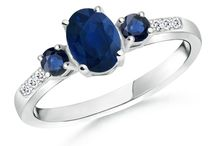 Oval-Round-Three-Stone-Sapphire-Ring-With-Diamond-Accents
