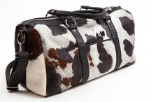 3.7.6. Weekender Bag FORNAX FNX92 (314663) / Spotted cow's hide and black natural leather, black fabric inside Size (mm) 540 x 230 x 280