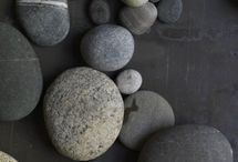 stacked rocks and sand dollars / by Kathy Emelander