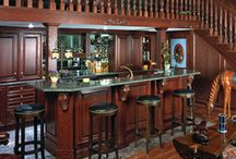 Equestrian's Dream / Giddyup! This horse lover's dream includes a viewing room overlooking a private indoor riding arena. Exclusively designed with Wood-Mode for the equestrian, the unique space includes horse head corbels, competition jumping overlays and under stairs pull-out blanket storage.  (Courtesy of Atwood: Fine Architectural Cabinetry - Asheville, NC and Greenville, SC)