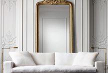 Large mirror behind sofa