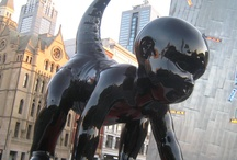 """Within Walking Distance / """"Mischievous monstrosities descended on Melbourne in 2011, as the city's CBD became a playground for a flock of fiendish cherubs...  Along Swanston Street and St Kilda Road these demonic angels - or angelic demons? - arrived, surveying the city's occupants with otherworldly eyes.  However, this apocalyptic parade did not constitute the end of the world; it was the beginning of a new one...as the Angels-Demons are infants."""