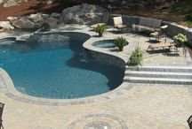 "TORRISON  PORTFOLIO || Pool Decks / There are so many choices when designing your pool scape. Today's designs provide plenty of reasons to keep people poolside, long after the last swimmer is out of the pool. Thoughtful outdoor living designs help homeowners capitalize on an often ""too short"" warm-weather season."