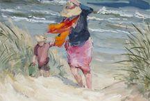 Going home - moeder en kind verlaten strand