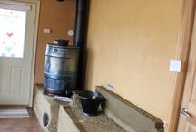 """Rocket Mass Heating Stoves / Combining rocket stoves ( a VERY efficient way to burn wood) and a """"mass"""" that can retain the heat generated by the rocket stove = cheap heating!  Here are some excellent examples of rocket mass heating stoves and some how-to links."""