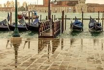 Euroguides Italy, Venice / Venice is a city in northeastern Italy sited on a group of 118 small islands separated by canals and linked by bridges. It is located in the marshy Venetian Lagoon which stretches along the shoreline, between the mouths of the Po and the Piave Rivers. Venice is renowned for the beauty of its setting, its architecture and its artworks.  The name is derived from the ancient Veneti people who inhabited the region by the 10th century BC.