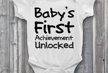 """Baby's First / Being a gamer parent your little baby is bound to have """"gamer firsts"""". Level1Gamers gets you and we've made adorable baby onesies for when those """"firsts"""" happen. Whether it be your little ones first Boss Fight or Kill Streak, we've got you covered. We hand press high quality vinyl onto each soft cotton bodysuit which is great for delicate skin. Comes in many sizes and is unisex for boys and girls alike."""