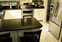 Kitchen dark counter light floor