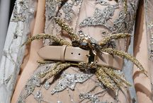 Belt Focus / A focus on the belts of the Haute Couture Autumn Winter 2016-17 collection complementing the embroidered details of the New York inspired Haute Couture gowns. Feathers and crystals delicately suspend in embellished vibrant colors referencing to the magnetizing bird pattern of this season's collection. From plain velvet creations to elaborately adorned designs indulge in the details of #ImpressionsofNY