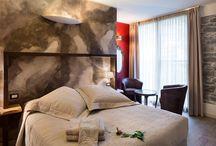 Camera Fuoco / Tra il predominare del legno e ferro spicca la passione del rosso che riapre il cuore in un armonia di colori caldi.