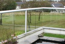 Case Study: Isle of Man / 33 metre Glass Balustrade with a white powder coated handrail in Isle of Man property   Read more here:  http://www.balconette.co.uk/blog/index.php/glass-balustrade-protects-isle-of-man-garden/