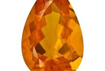 Fire opal / Fire opal (named after its orange colour) has red, orange, yellow body colour. It doesn't always show play-of-colour and is usually milky and turbid. The best qualities are clear and transparent, it makes them suitable for being faceted. They are very sensitive to every stress.