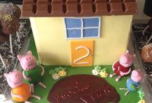 Peppa Pig's House Cake / Rainbow baked layered sponge cake, covered with sugar paste icing & figures made from sugar paste