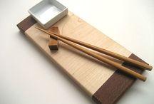 chopsticks and sushi board