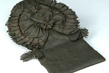 Cockades on Queue Bags / Male hairstyles of the 1700s were often fashioned with long hair pulled back into a ponytail, known in the eighteenth century by the French term queue. Wig bags either covered the queue or served as a buffer to protect costly fabrics from contact with the natural hair oil.