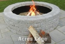 Firepits / There is nothing quite like the comfort of a glowing campfire. Now you can safely bring the campfire home and incorporate it into your backyard landscape. Fire pits are built on a level base with retaining wall blocks in a circular or square kit and include an insert.