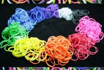Rainbow Rubber Band and Looms for Bracelet Making / We sell DIY Loom Rubber Band Bracelet Making Kits.  Each one comes with a Loom, a hook tool, 600 multi colored  rubber bands (10 colors- red, orange, yellow, lime green, light blue, blue, purple, hot pink, white and black) and 25 S Rings/Infinity Clips. We carry a Rainbow of colored rubber bands in lots of 600, 1200, 2400 and 6000.
