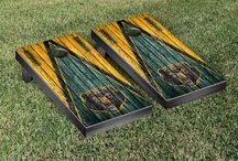 "Big 12 Gamedays | Victory Tailgate / Our officially licensed collegiate cornhole games are made proudly in the USA. Each cornhole set comes with two 24""x48"" regulation boards with folding legs, a complete bag set (8 bags), and a FREE string pack to carry the bags (A $10 value!)."