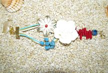 Leather Flowers Jewellery / This is a collection of jewelry made with leather flowers, fimo flowers, glass beads, crystals, chains, metal findings, leather cords, wax cords and various other materials.