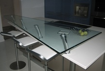 Glass Counters & Vanities / Our glass vanities and counter tops are virtually all custom-made and are available in a variety of colors, textures and can include a contemporary or custom design melded in between two pieces of glass.
