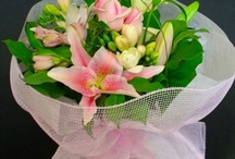 Wrapped presentation bouquets  / by Sophisticated Floral Designs