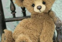 """teddy bears / The name Teddy Bear comes from former United States President Theodore Roosevelt, whose nickname was """"Teddy"""".  Read the story of the Teddy Bear: http://www.theodoreroosevelt.org/kidscorner/tr_teddy.htm Early teddy bears were made to look like real bears, with extended snouts and beady eyes. Today's teddy bears tend to have larger eyes and foreheads and smaller noses, babylike features that make them more attractive to buyers because they enhance the toy's cuteness, and may even be pre-dressed."""
