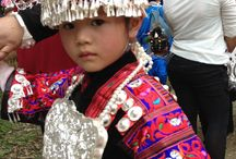 little girl in Taijiang / A dressed up little girl in Taijiang County.She looks very qute and she has pure eyes!Her coustume was decorated with silver ornaments!