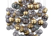 """Chandelier Bubble Buzz - Mollini / Hanging lamp with chromed silver plafon. Originality of the lamp is hiden in glass balls hanging on wires with different lengths. Decorative effect of """"soap bubbles"""" is emphasized by smoked colours of gray and stylish gold.   Specyfikacion: Material: metal/glass  Colour of metal: chrom Colour of glass: smoked grey, amber gold  Number of bulbs: 6*GU10/50W  (not included)"""
