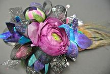 PROM FLOWERS / Styles have changed in the past five years for Prom Corsages and Bouts. Eye catching designs ,Bracelets, Gems, Feathers, Ribbons, ect.