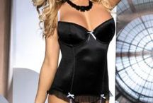 Sexy Corsets and Corset Sets / A mix of sexy corsets and corset lingerie sets. Some corset sets come with suspender straps. Super flattering and super sexy corsets